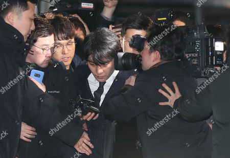 K-pop idol Seungri struggles his way through the press as he leaves the Seoul  Metropolitan Police Agency in the capital after some 16 hours of questioning on suspicions that he solicited sexual favors for his business partners, in Seoul, South Korea, 15 March 2019. The singer, whose real name is Lee Seung-hyun, allegedly arranged sex services for potential investors. A deeper probe has since uncovered suspicions of drug abuse, rape and collusion with district police.