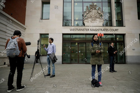 Members of the media report from outside Westminster Magistrates Court in London, shortly after fugitive Indian diamond tycoon Nirav Modi was denied bail in a hearing, . Modi, who is wanted over his alleged involvement in a $2 billion banking fraud, has been arrested in London at the request of Indian authorities