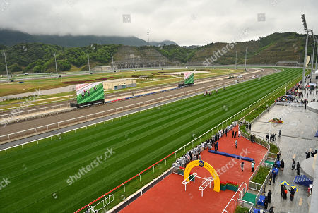 Nordic Warrior, ridden by Matthew Chadwick, wins The Hong Kong Jockey Club Trophy, the first ever race at the course.