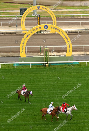(No 4) Nordic Warrior, ridden by Matthew Chadwick, is led back down the course after winning The Hong Kong Jockey Club Trophy, the first ever race at the course.