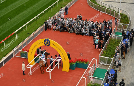 Nordic Warrior, ridden by Matthew Chadwick, is led into the winners enclosure after winning The Hong Kong Jockey Club Trophy, the first ever race at the course.