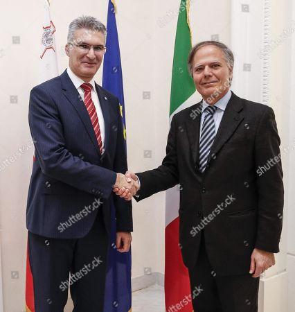 Italian FM Enzo Moavero Milanesi (R) shakes hands with Malta FM Carmelo Abela prior their meeting at Farnesina in Rome, Italy, 20 March 2019.