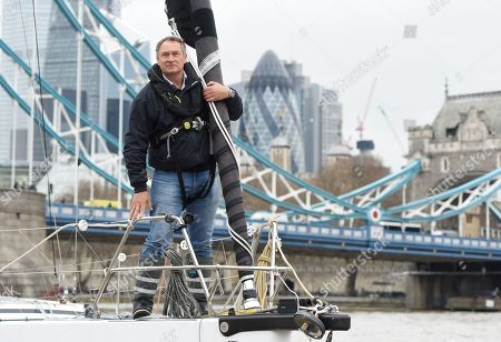 British adventurer Sir David Hempleman-Adams sails underneath the Tower Bridge to launch his attempt to sail solo to New York in London, Britain, 20 March 2019. Sir David's journey is to raise awareness of the St John Ambulance charity.