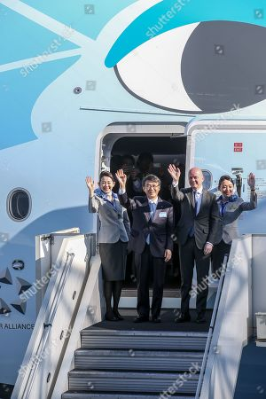President and CEO of ANA Holdings Inc Shinya Katanozaka (L) and Stephane Ginoux, head of country Japan (R), wave to media before the first Airbus A380 delivered to All Nippon Airways (ANA), the largest airline in Japan, takes off at the Airbus delivery center in Colomiers, near Toulouse, southern France, 20 March 2019.