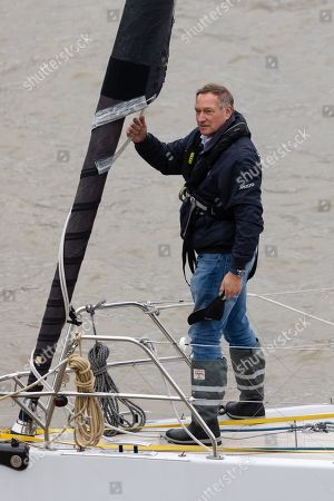 Stock Photo of Sir David Hempleman-Adams sails his yacht, Chione underneath Tower Bridge in London to launch his attempt to sail solo to New York to raise awareness of the St John Ambulance charity.