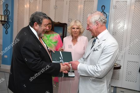 Prime Minister Ralph Gonsalves greets Camilla Duchess of Cornwall and Prince Charles at the Governor-General's reception at the official residence of the Prime Minister, Kingstown