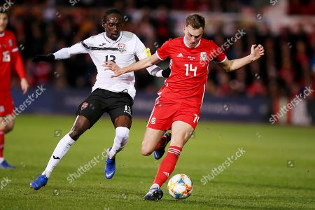 Nathan Lewis of Trinidad and Tobago and Ryan Hedges of Wales