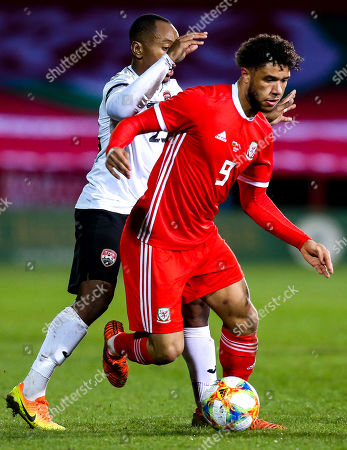 Tyler Roberts of Wales takes on Leston Paul of Trinidad and Tobago