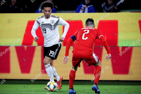Germany's Leroy Sane (L) in action against Serbia's Antonio Rukavina (R) during the international friendly soccer match between Germany and Serbia in Wolfsburg, Germany, 20 March 2019.