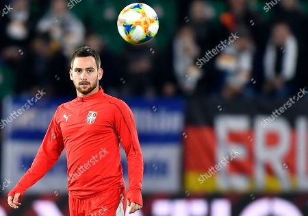 Serbia's Andrija Zivkovic looks on during warm up prior to a international friendly soccer match between Germany and Serbia at the Volkswagen Arena stadium in Wolfsburg, Germany
