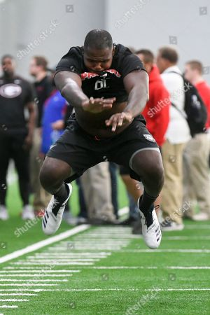 Jay Hayes leaps in a football drill during Georgia Pro Day, in Athens, Ga