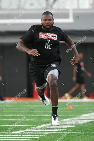 Jay Hayes runs a football drill during Georgia Pro Day, in Athens, Ga