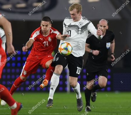 Germany´s Julian Brandt (R) in action against Serbia´s Mijat Gacinovic (L) during the international friendly soccer match between Germany and Serbia in Wolfsburg, Germany, 20 March 2019.