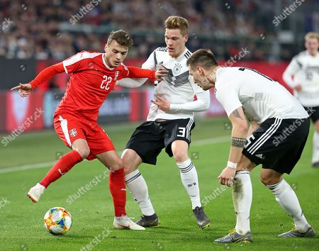 20.03.2019, Football,  , Germany - Serbien, in Volkswagen Arena Wolfsburg. (L-R) Adem Ljajic (Serbien)  -  Marcel Halstenberg (Germany) and Niklas Suele (Germany)