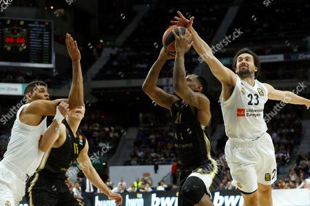 Real Madrid's Sergio Llull (R) in action against Armani Milan's James Nunnally (2-R) during a Euroleague basketball match between Real Madrid and Armani Milan at the Sports Palace venue in Madrid, Spain, 20 March 2019.