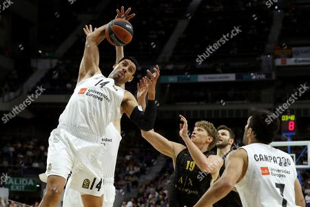 Real Madrid's Gustavo Ayon (L) in action against Armani Milan's Mindaugas Kuzminskas (2-R) during a Euroleague basketball match between Real Madrid and Armani Milan at the Sports Palace venue in Madrid, Spain, 20 March 2019.