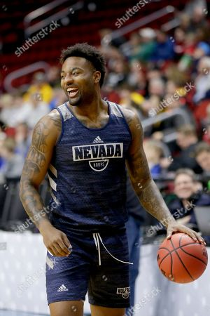 Stock Photo of Nevada's Jordan Caroline smiles during team practice ahead of a first round men's college basketball game against Florida in the NCAA Tournament in Des Moines, Iowa, . At 6-foot-7 and 235 pounds, Jordan Caroline has a football player's build just like dad. The son of former NFL defensive end Simeon Rice, and grandson of ex-Chicago Bear J.C. Caroline is making a name for himself as Nevada's top scorer and rebounder