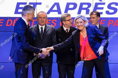 Les Republicains' (LR) president Laurent Wauquiez (2nd L) and Rassemblement National's (RN) president Marine Le Pen shake hands as they arrive for a picture with others French political party chiefs (From L) La Republique en Marche's (LREM) Stanislas Guerini, MoDem's Francois Bayrou, La France Insoumise (LFI)'s Jean-Luc Melenchon, and Parti Socialist (PS)'s Olivier Faure, ahead of a debate organised by French BFM TV private news channel in Paris, France, 20 March 2019.