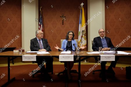 Deacon Daniel Welter, Chancellor to the Archdiocese of Chicago (L) and John O'Malley, Special Counsel to the Archdiocese of Chicago (R) listen to Mary Jane Doerr, Director, Office for the Protection of Children and Youth for the Archdiocese of Chicago responds to the release a 185-report on clergy sexual abuse within the Catholic Archdiocese of Chicago and the Dioceses of Belleville, Joliet, Peoria, Rockford and Springfield during a press conference at the Archbishop Quigley Center in Chicago, Illinois, USA, 20 March 2019. The report revealed the identities, background information, photographs and histories of 395 Catholic clergy and laypersons accused of sexual misconduct.