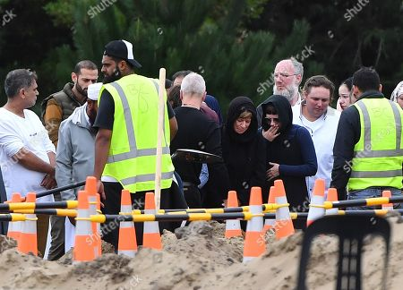 Family members mourn at the funeral of Linda Susan Armstrong during the ninth funeral for the 50 victims of the mosque shootings, at the Memorial Park Cemetery in Christchurch, New Zealand, 21 March 2019. New Zealand Prime Minister Jacinda Ardern announced on 21 March, that New Zealand will ban all types of semi-automatic weapons used in Christchurch attacks after a gunman killed 50 worshippers at the Al Noor Masjid and Linwood Masjid on 15 March.