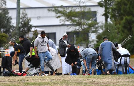 Mourners wash themselves before the funeral of Linda Susan Armstrong during the ninth funeral for the 50 victims of the mosque shootings, at the Memorial Park Cemetery in Christchurch, New Zealand, 21 March 2019. New Zealand Prime Minister Jacinda Ardern announced on 21 March, that New Zealand will ban all types of semi-automatic weapons used in Christchurch attacks after a gunman killed 50 worshippers at the Al Noor Masjid and Linwood Masjid on 15 March.