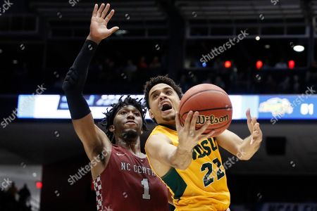 Cameron Hunter, Zacarry Douglas. North Dakota State's Cameron Hunter (22) shoots against North Carolina Central's Zacarry Douglas (1) during the second half of a First Four game of the NCAA men's college basketball tournament, in Dayton, Ohio