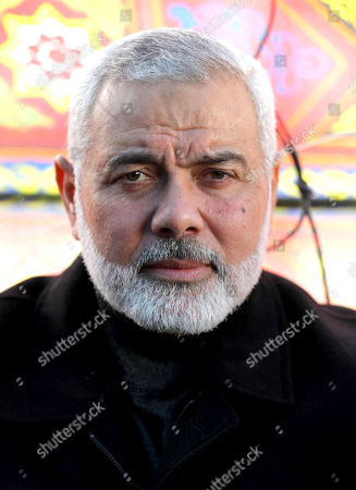 Palestinian Hamas Chief Ismail Haniyeh attends a consolation ceremony following Israeli security forces killing of Omar Abu Leila in Ebwin