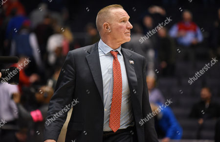 Stock Image of St. John's Red Storm head coach Chris Mullin walks off the court following a loss to Arizona State at the NCAA First Four game between the St. John's Red Storm and the Arizona State Sun Devils at the University of Dayton Arena in Dayton, Ohio