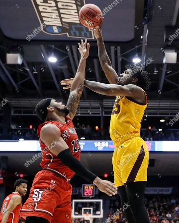 Romello White, Marvin Clark II. Arizona State's Romello White, right, shoots over St. John's Marvin Clark II (13) during the first half of a First Four game of the NCAA men's college basketball tournament, in Dayton, Ohio