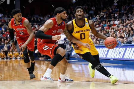 Luguentz Dort, Marvin Clark II. Arizona State's Luguentz Dort (0) drives against St. John's Marvin Clark II, center, during the first half of a First Four game of the NCAA men's college basketball tournament, in Dayton, Ohio
