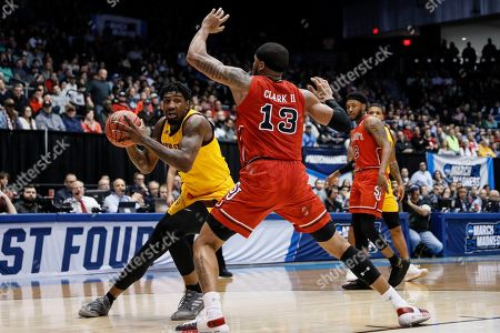 Romello White, Marvin Clark II. Arizona State's Romello White, left, looks to pass the ball around St. John's Marvin Clark II (13) during the first half of a First Four game of the NCAA men's college basketball tournament, in Dayton, Ohio