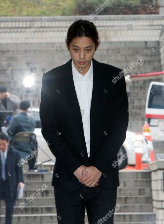 South Korean K-pop star Jung Joon-young arrives at the Seoul District Court in Seoul, South Korea, 21 March 2019. The popstar was at court to attend a hearing after he admitted to secretly filming himself engaging in sexual activities with ten or more women and sharing the footage.