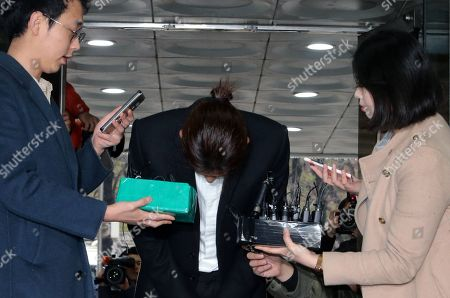 South Korean K-pop star Jung Joon-young (C) bows as he speaks to the media at the Seoul District Court in Seoul, South Korea, 21 March 2019. The popstar was at court to attend a hearing after he admitted to secretly filming himself engaging in sexual activities with ten or more women and sharing the footage.