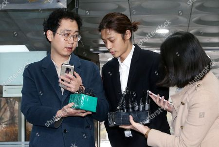 South Korean K-pop star Jung Joon-young (C) arrives at the Seoul District Court in Seoul, South Korea, 21 March 2019. The popstar was at court to attend a hearing after he admitted to secretly filming himself engaging in sexual activities with ten or more women and sharing the footage.