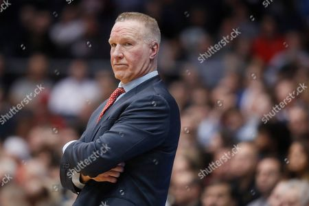 Stock Picture of St. John's head coach Chris Mullin works the bench during the first half of a First Four game of the NCAA college basketball tournament against Arizona State, in Dayton, Ohio