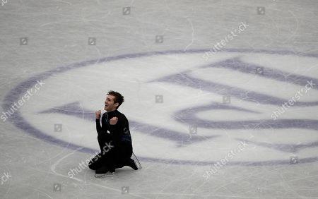 Jason Brown from the U.S. celebrates after performing his men's short program routine during the ISU World Figure Skating Championships at Saitama Super Arena in Saitama, north of Tokyo