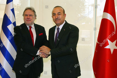 Foreign Minister of Turkey Mevlut Cavusoglu (R) and Greek Foreign Affairs Minister Giorgos Katrougalos (L) shake hands during a meeting in Antalya, Turkey, 21 March 2019. Greek Foreign Minister is in Turkey on an one-day working visit.