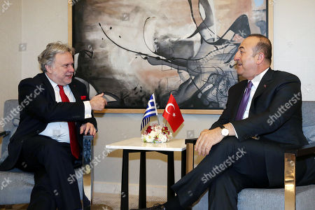 Foreign Minister of Turkey Mevlut Cavusoglu (R) and Greek Foreign Affairs Minister Giorgos Katrougalos (L) speak during a meeting in Antalya, Turkey, 21 March 2019. Greek Foreign Minister is in Turkey on an one-day working visit.