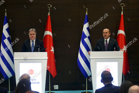Foreign Minister of Turkey Mevlut Cavusoglu (R) and Greek Foreign Minister Giorgos Katrougalos (L) attend a joint press conference after their meeting in Antalya, Turkey, 21 March 2019. Greek Foreign Minister Giorgos Katrougalos is in Turkey on an one-day official visit.
