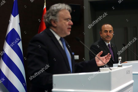 Foreign Minister of Turkey Mevlut Cavusoglu (R) listens as Greek Foreign Minister Giorgos Katrougalos speaks (L) during a joint press conference after their meeting in Antalya, Turkey, 21 March 2019. Greek Foreign Minister Giorgos Katrougalos is in Turkey on an one-day official visit.
