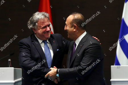 Foreign Minister of Turkey Mevlut Cavusoglu (R) and Greek Foreign Minister Giorgos Katrougalos (L) shake hands after their meeting in Antalya, Turkey, 21 March 2019. Greek Foreign Minister Giorgos Katrougalos is in Turkey on an one-day official visit.