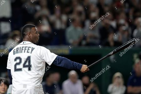 Former Seattle Mariners and Baseball Hall of Fame player George Kenneth 'Ken' Griffey Jr. prepares for the ceremonial first pitch by former Oakland Athletics player Keiichi Yabu (not pictured) prior to the start of the second game between the Oakland Athletics and the Seattle Mariners during the Major League Baseball (MLB) Opening Games at Tokyo Dome in Tokyo, Japan, 21 March 2019.