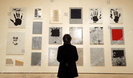 A man looks at some works of US Neo-conceptual artist Jenny Holzer at Guggenheim Museum in Bilbao, Spain, 21 March 2019. The exhibition Jenny Holzer: Thing Indescribable will be open to public from 22 March to 09 September 2019.