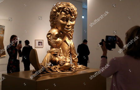"""""""Michael Jackson and Bubbles (Gold)"""" of 1999 from the US-Artist Paul McCarthy are seen during a press preview of the exhibition 'Michael Jackson: On the Wall' at the Bundeskunsthalle in Bonn, Germany, 21 March 2019. The show explores the influence of late US musician Michael Jackson in contemporary art. It runs from 22 March to 14 July 2019."""