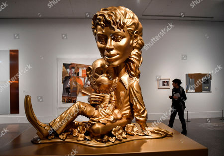 The sculpture 'Michael Jackson and Bubbles' from US artist Paul McCarthy' is presented at a preview of the exhibition 'Michael Jackson: On The Wall' at the Bundeskunsthalle museum in Bonn, Germany, . The exhibition around the controversial iconic pop idol is open until July 14