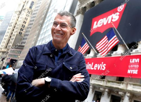 Levi Strauss CEO Chip Bergh poses for photos outside the New York Stock Exchange, . Levi Strauss & Co., which gave America its first pair of blue jeans, is going public for the second time. The 166-year-old company, which owns the Dockers and Denizen brands, previously went public in 1971, but the namesake founder's descendants took it private again in 1985