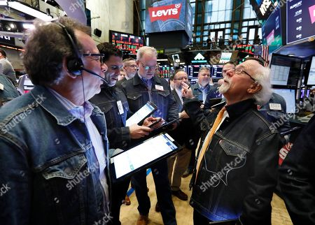 """People work on the trading floor of the New York Stock Exchange, . The """"No Blue Jeans"""" rule was relaxed on the trading floor for the listing of Levi Strauss. The company, which gave America its first pair of blue jeans, is public again, for the second time"""