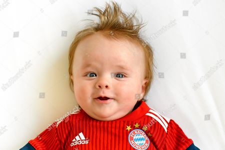MODEL RELEASED Baby, 3 months, in jersey of FC Bayern Munich, Portrait, Baden-Wuerttemberg, Germany