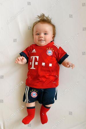 MODEL RELEASED Baby, 3 months, in jersey of FC Bayern Munich, Baden-Wuerttemberg, Germany