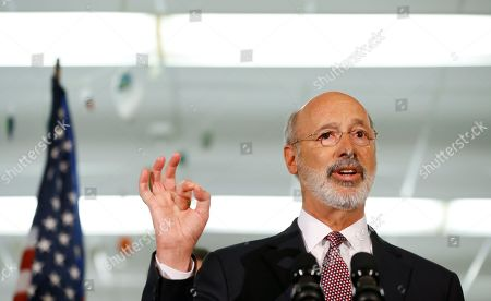 Pennsylvania Gov. Tom Wolf speaks during a news conference at the John H. Taggart School library, in Philadelphia. Wolf discussed his infrastructure package, Restore Pennsylvania, to help remediate contaminants from Pennsylvania schools